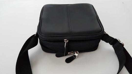 Preload https://item1.tradesy.com/images/coach-limited-edition-camera-cd-black-leather-and-nylon-cross-body-bag-21548970-0-0.jpg?width=440&height=440