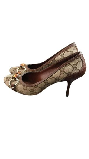Preload https://item3.tradesy.com/images/gucci-brown-gg-monogram-pumps-size-us-75-regular-m-b-21549297-0-1.jpg?width=440&height=440