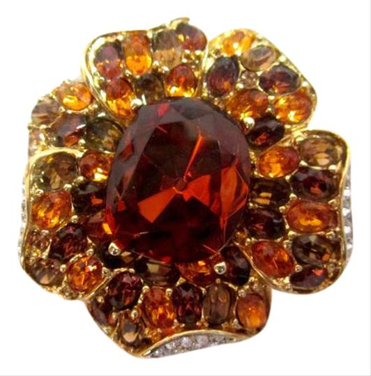 Preload https://item2.tradesy.com/images/kenneth-jay-lane-amber-brown-flower-pin-sparkly-crystal-gold-white-colors-21549401-0-1.jpg?width=440&height=440