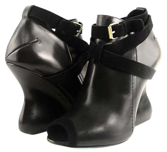 Preload https://item3.tradesy.com/images/costume-national-black-1115625-leather-peep-eur-375-bootsbooties-size-us-65-regular-m-b-21550787-0-1.jpg?width=440&height=440