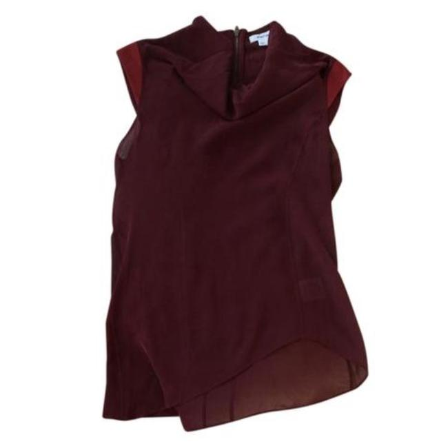 Preload https://img-static.tradesy.com/item/21550795/helmut-lang-burgundy-silk-and-suede-asymmetrical-sheer-blouse-size-petite-2-xs-0-0-650-650.jpg