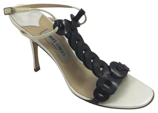 Preload https://img-static.tradesy.com/item/21551327/jimmy-choo-black-white-patent-t-strap-sandal-pumps-size-eu-395-approx-us-95-regular-m-b-0-2-540-540.jpg