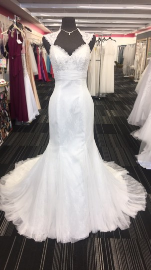 Preload https://item4.tradesy.com/images/ivory-lace-1038-traditional-wedding-dress-size-8-m-21551653-0-0.jpg?width=440&height=440