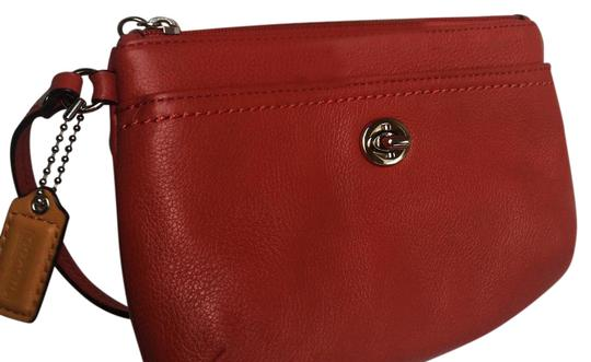 Preload https://item3.tradesy.com/images/coach-park-fire-red-leather-clutch-21551747-0-1.jpg?width=440&height=440