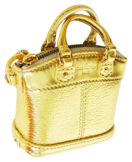 Preload https://item5.tradesy.com/images/louis-vuitton-gold-lockit-collector-must-see-mini-21551779-0-1.jpg?width=440&height=440