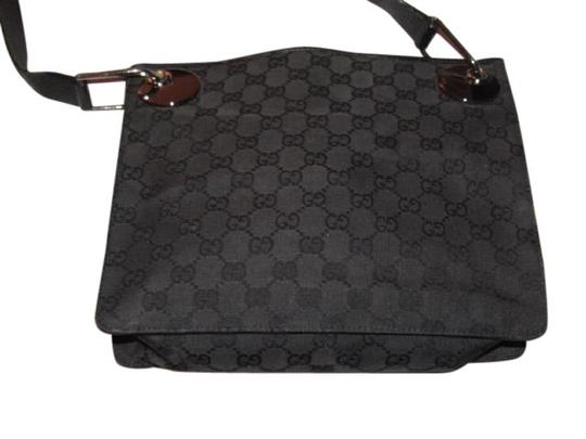 Preload https://item4.tradesy.com/images/gucci-newer-pursesdesigner-purses-black-leather-and-black-large-g-logo-print-canvas-with-a-nylon-str-21553428-0-1.jpg?width=440&height=440