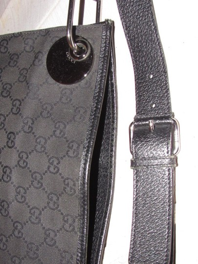 Gucci Messenger/Cross Body Unisex Style Mint Condition Canvas/Leather Bold Chrome Accents black leather & black large G logo print canvas with a nylon strap Messenger Bag