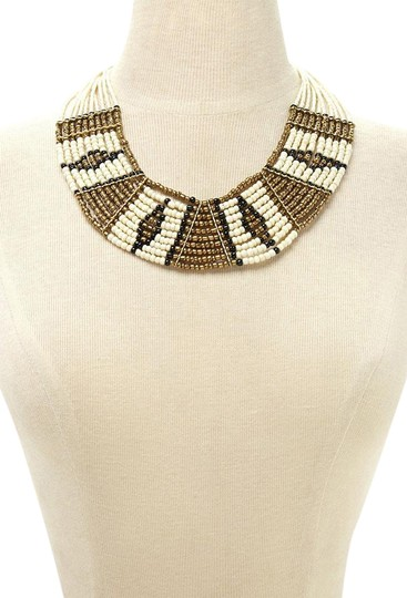 Preload https://item5.tradesy.com/images/black-gold-beaded-statement-tribal-african-ivory-bib-necklace-21554484-0-1.jpg?width=440&height=440