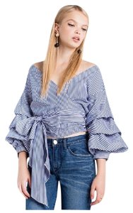 Preload https://item5.tradesy.com/images/blue-and-white-stripe-puff-sleeve-wrap-da33-blouse-size-6-s-21554614-0-1.jpg?width=400&height=650