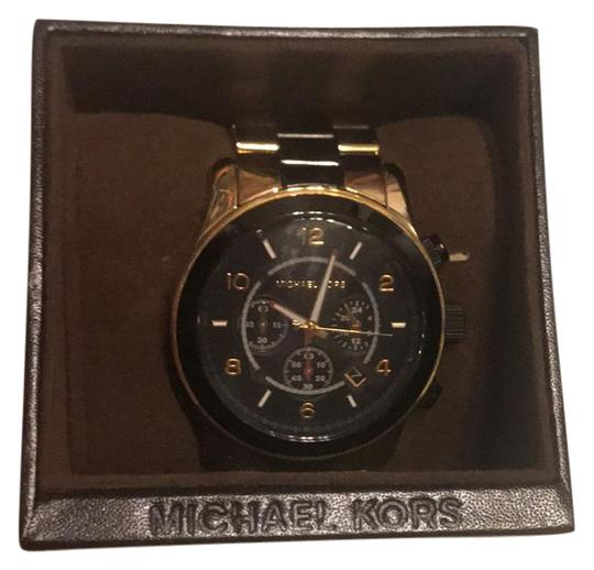 Preload https://item5.tradesy.com/images/michael-kors-black-and-gold-watch-21554954-0-1.jpg?width=440&height=440