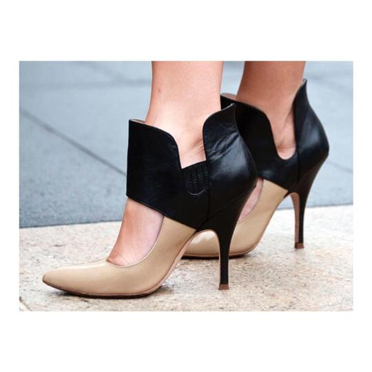 Preload https://item5.tradesy.com/images/jean-michel-cazabat-nude-and-black-isola-pumps-size-us-8-regular-m-b-21554979-0-0.jpg?width=440&height=440
