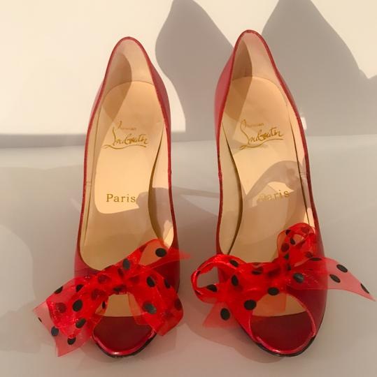 Christian Louboutin red with black polka dots! So fun! worn once indoors. Pumps