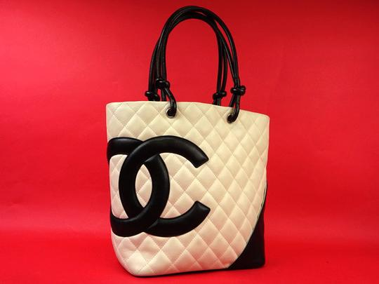 Preload https://item4.tradesy.com/images/chanel-cambon-ligne-219719-white-x-black-quilted-leather-tote-21555158-0-0.jpg?width=440&height=440