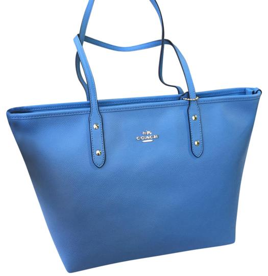 Preload https://item3.tradesy.com/images/coach-zip-blue-100leather-tote-21555952-0-1.jpg?width=440&height=440
