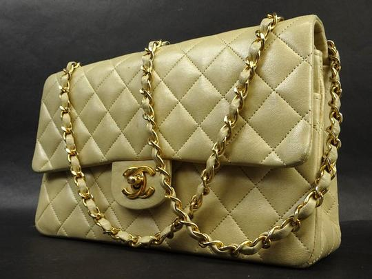 Preload https://item2.tradesy.com/images/chanel-quilted-lambskin-medium-classic-double-flap-219410-beige-leather-shoulder-bag-21556191-0-0.jpg?width=440&height=440