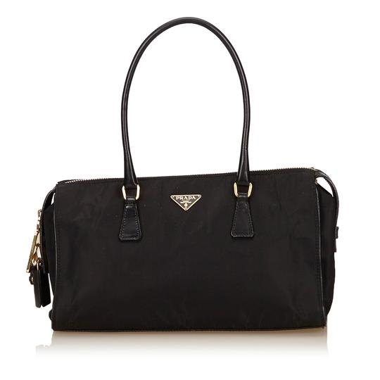 Preload https://img-static.tradesy.com/item/21556385/prada-nylon-handbag-black-fabric-baguette-0-0-540-540.jpg