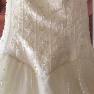 Preload https://item4.tradesy.com/images/alfred-angelo-ivory-satin-and-tulle-hand-stitched-formal-wedding-dress-size-16-xl-plus-0x-21556618-0-0.jpg?width=440&height=440