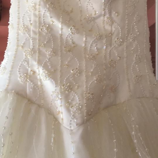 Preload https://img-static.tradesy.com/item/21556618/alfred-angelo-ivory-satin-and-tulle-hand-stitched-formal-wedding-dress-size-16-xl-plus-0x-0-0-540-540.jpg