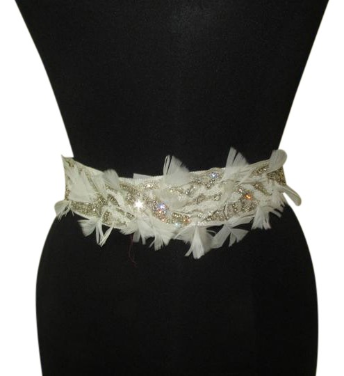 Preload https://item4.tradesy.com/images/bridal-sash-ivory-beads-and-rhinestone-with-feather-belt-21556853-0-2.jpg?width=440&height=440