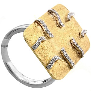 ABC Jewelry 18kt yellow and white gold ring that has .13ct g/si1
