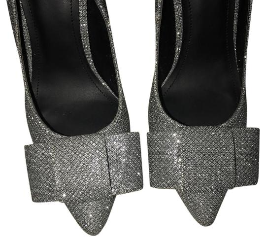Preload https://item2.tradesy.com/images/h-and-m-silverblack-bow-wedge-formal-shoes-size-us-6-regular-m-b-21557761-0-1.jpg?width=440&height=440