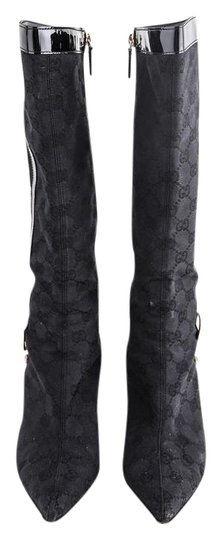 Preload https://item4.tradesy.com/images/gucci-stiletto-high-logo-canvas-patent-leather-trim-black-bootsbooties-size-us-65-regular-m-b-21557968-0-1.jpg?width=440&height=440