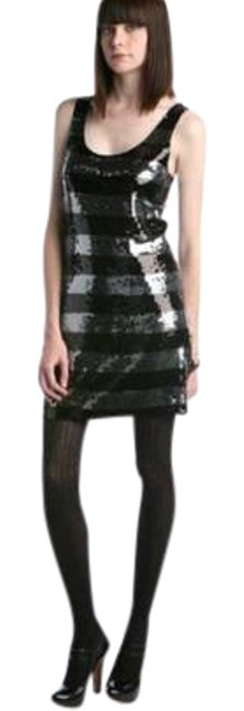 Preload https://item3.tradesy.com/images/black-and-silver-sequins-racer-short-night-out-dress-size-12-l-21558007-0-2.jpg?width=400&height=650
