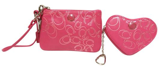 Preload https://item1.tradesy.com/images/coach-veryrarecoachmatchingwristlet-and-heartcoinpouch-pink-leather-wristlet-21558720-0-2.jpg?width=440&height=440