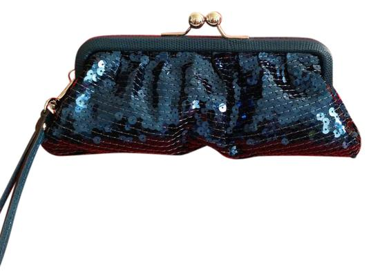 Preload https://img-static.tradesy.com/item/21559352/coach-occasion-sequin-framed-wristlet-49900-silverteal-clutch-0-2-540-540.jpg