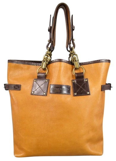 Preload https://item3.tradesy.com/images/dsquared2-and-brown-leather-double-perforated-strap-tan-tote-21559422-0-1.jpg?width=440&height=440