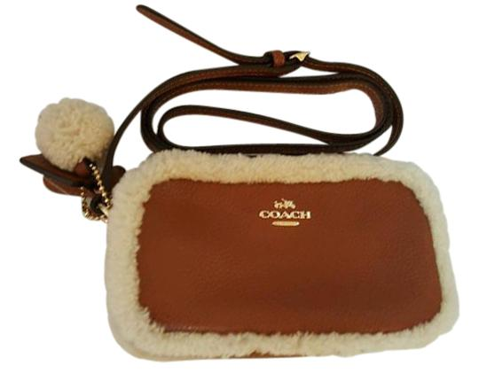 Preload https://item3.tradesy.com/images/coach-shearling-slate-pouch-f64706-saddlenatural-leather-cross-body-bag-21559837-0-2.jpg?width=440&height=440