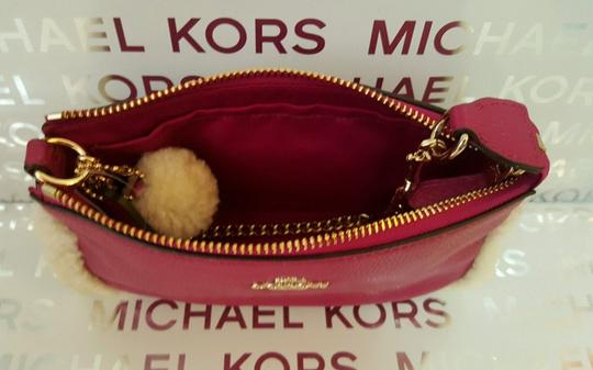 Coach Wristlet in Cranberry