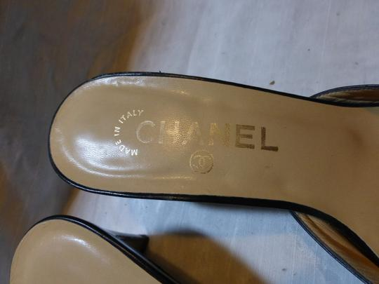 Chanel black leather Mules