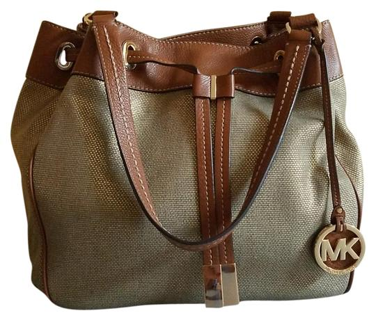 Preload https://item2.tradesy.com/images/michael-kors-marina-large-drawstring-gold-cotton-canvas-and-leather-tote-21560901-0-2.jpg?width=440&height=440