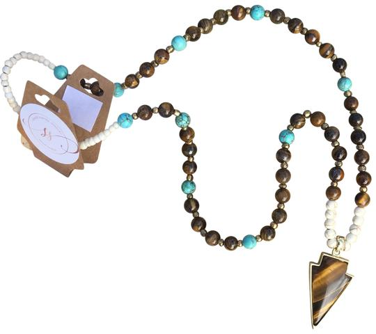 Preload https://item3.tradesy.com/images/turquoise-and-brown-beaded-arrowhead-made-in-tx-necklace-21561527-0-4.jpg?width=440&height=440