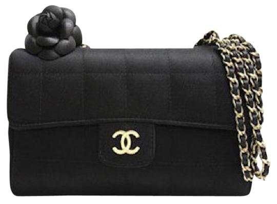 Preload https://item4.tradesy.com/images/chanel-classic-flap-camellia-mini-chocolate-bar-square-quilted-cc-logo-black-satin-shoulder-bag-21561818-0-1.jpg?width=440&height=440