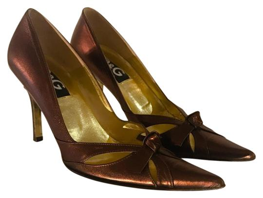 Preload https://item3.tradesy.com/images/dolce-and-gabbana-bronze-leather-tie-pointy-pumps-size-us-7-regular-m-b-21561872-0-1.jpg?width=440&height=440