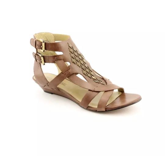 Preload https://item5.tradesy.com/images/joan-and-david-brown-studded-bechira-wedge-sandals-size-us-85-regular-m-b-21563414-0-0.jpg?width=440&height=440