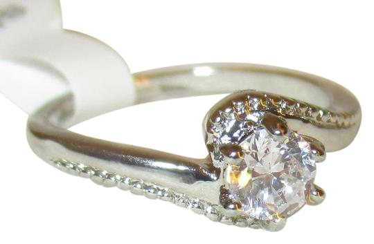 Preload https://item4.tradesy.com/images/clear-925-sterling-silver-12-carat-simulated-diamond-swirlring-size-8-ring-21564488-0-1.jpg?width=440&height=440
