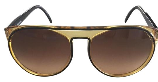 Preload https://item2.tradesy.com/images/playboy-yellow-vintage-optyl-sunglasses-21564606-0-1.jpg?width=440&height=440