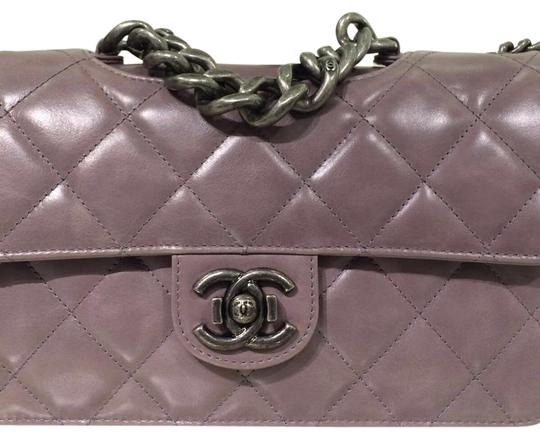 Preload https://item3.tradesy.com/images/chanel-classic-flap-rusted-pink-lambskin-leather-shoulder-bag-21565007-0-2.jpg?width=440&height=440