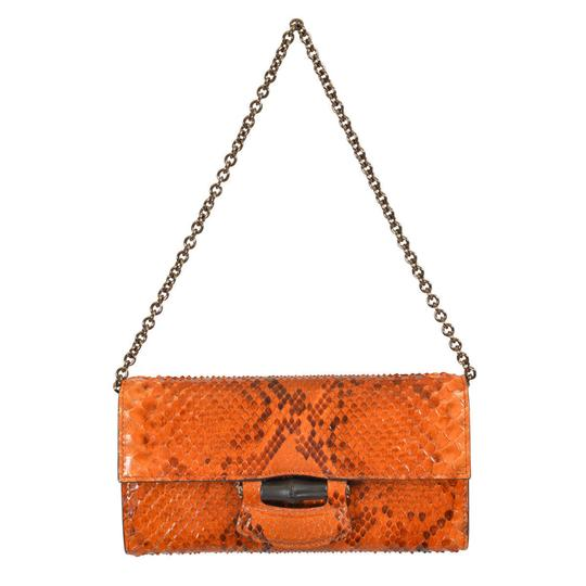 Preload https://item2.tradesy.com/images/gucci-women-s-handbag-shoulder-orange-python-skin-clutch-21565171-0-0.jpg?width=440&height=440