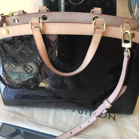 Louis Vuitton Satchel in amarente