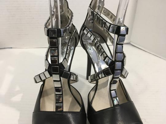 MICHAEL Michael Kors Upper Stilettos Black leather heels, lining, insoles leather, T and side straps covered silver metal plates back zippers small platform Sandals