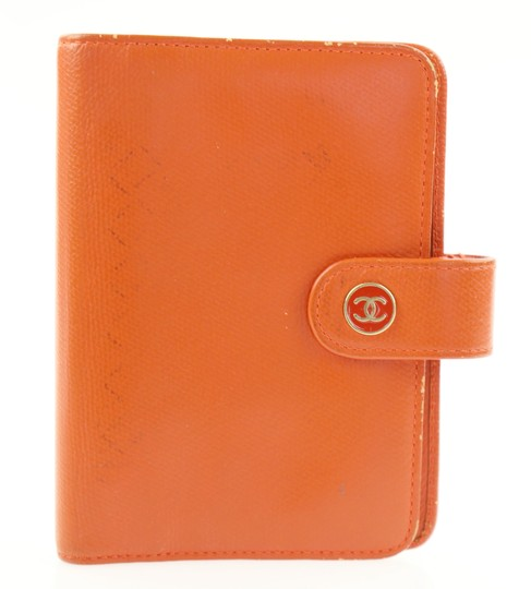 Preload https://item1.tradesy.com/images/chanel-orange-day-planner-cover-wallet-21567410-0-3.jpg?width=440&height=440