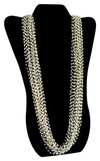 Preload https://item5.tradesy.com/images/gold-tone-white-necklace-21567809-0-2.jpg?width=440&height=440