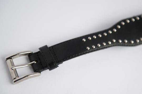 Free People Black belt with hardware around the belt.