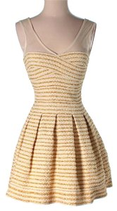 Dainty Hooligan short dress White and Gold on Tradesy