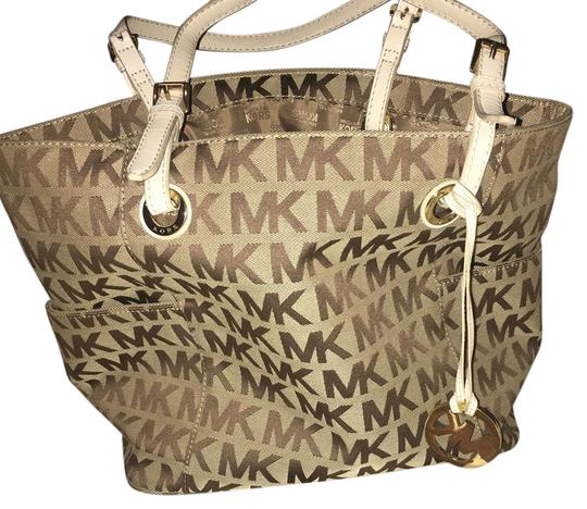 Preload https://item2.tradesy.com/images/michael-kors-white-beige-and-brown-tote-21569021-0-1.jpg?width=440&height=440