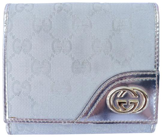 Preload https://img-static.tradesy.com/item/21569113/gucci-silver-gg-canvas-britt-wallet-0-3-540-540.jpg